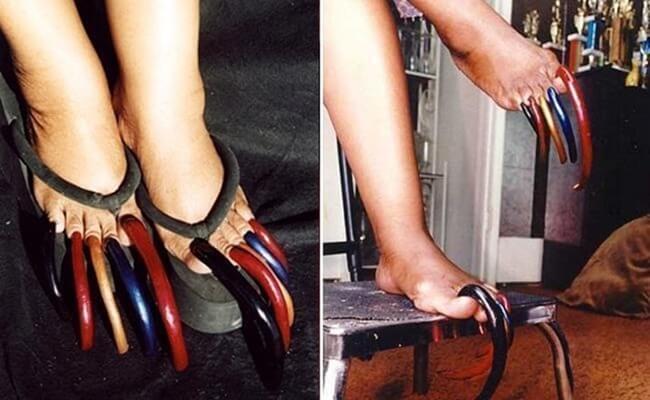 Луиза Холлис носит самые длинные ногти на ногах